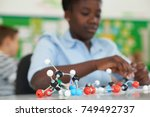 female pupil using molecular... | Shutterstock . vector #749492737