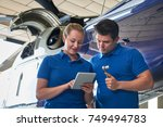 aero engineer and apprentice... | Shutterstock . vector #749494783