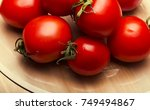a lot of red tomatoes on glass... | Shutterstock . vector #749494867