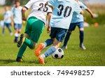 boys kicking soccer match on... | Shutterstock . vector #749498257