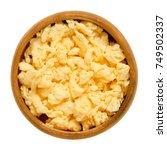scrambled eggs in wooden bowl.... | Shutterstock . vector #749502337