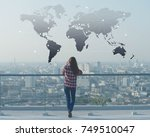 woman use smartphone on rooftop ... | Shutterstock . vector #749510047