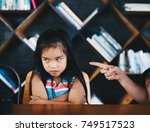 mother scolding to her baby... | Shutterstock . vector #749517523