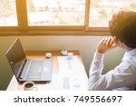 businessman sitting at office... | Shutterstock . vector #749556697