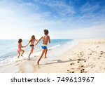 kids running along beach during ... | Shutterstock . vector #749613967