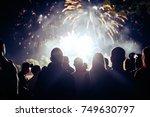 crowd watching fireworks | Shutterstock . vector #749630797