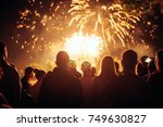 crowd watching fireworks | Shutterstock . vector #749630827