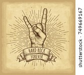 hand drawn hand gesture. rock... | Shutterstock .eps vector #749669167