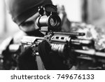 man aiming with an ak 47 with... | Shutterstock . vector #749676133