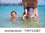 dad teaches you to swim the... | Shutterstock . vector #749714287