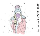 a girl in a stylish down jacket ... | Shutterstock .eps vector #749719057