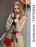 pretty woman in raincoat ... | Shutterstock . vector #749733943