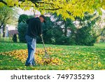 Old Man Raking Fallen Leaves I...