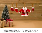 santa's clothes hanging on the... | Shutterstock . vector #749737897