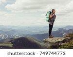 girl in mountains... | Shutterstock . vector #749744773