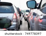cars on urban street in traffic ... | Shutterstock . vector #749778397