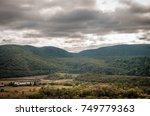 wide mountain range landscape....   Shutterstock . vector #749779363
