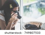 asian girl taking a photo of... | Shutterstock . vector #749807533