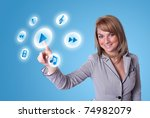Small photo of woman hand pressing media player button