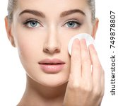 girl removes makeup with... | Shutterstock . vector #749878807