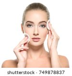 girl removes makeup with... | Shutterstock . vector #749878837
