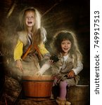 Small photo of two girls dress up as fairytale characters, fairytale character grandma ezhka, girls play and conjure