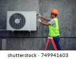 air conditioning technician and ... | Shutterstock . vector #749941603