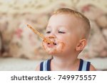 Small photo of Little Dirty-faced Boy Biting Ice-Cream Stick