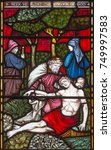 Small photo of LONDON, GREAT BRITAIN - SEPTEMBER 19, 2017: The Parable of the Good Samaritan on the stained glass in St Mary Abbot's church on Kensington High Street.