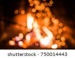 blurred background with burning ... | Shutterstock . vector #750014443