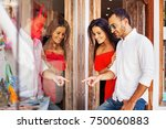 couple shopping and choosing... | Shutterstock . vector #750060883