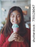 asian woman eating ice cream... | Shutterstock . vector #750128047