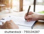 close up business man reaching...   Shutterstock . vector #750134287