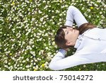 happy young woman lying on green grass - stock photo