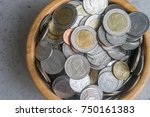Small photo of Thai Baht Coins Macro Close Up in Wooden Container with King of Thailand on obverse and Wat Arun on reverse. Ring made of Cupronickel and Center of Aluminium Bronze. Money Background