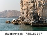 Rocky Cliff Face Rising Up Fro...