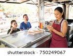 attractive female food truck... | Shutterstock . vector #750249067