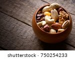 dried mixed nuts in wooden bowl ... | Shutterstock . vector #750254233