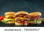 burgers on a dark background | Shutterstock . vector #750305917