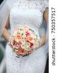 beauty wedding bouquet in bride'... | Shutterstock . vector #750357517