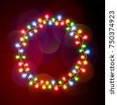round frame of christmas lights....   Shutterstock .eps vector #750374923