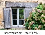 rustic wooden window on a stone ... | Shutterstock . vector #750412423