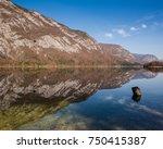 reflections in lake bohinj ... | Shutterstock . vector #750415387