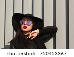 stylish young woman posing in... | Shutterstock . vector #750453367