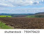 fields and clouds in the... | Shutterstock . vector #750470623