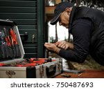 carpenter works to fix the new... | Shutterstock . vector #750487693