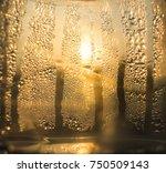 sunrise through misted glass.... | Shutterstock . vector #750509143