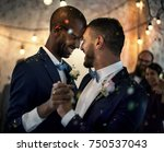 gay couple dancing on wedding... | Shutterstock . vector #750537043
