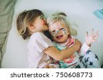 two little sisters in bed... | Shutterstock . vector #750608773