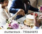 Couple Hands Cutting Wedding...